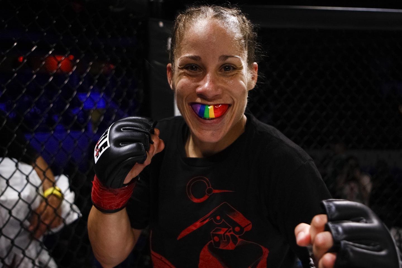 Liz Carmouche with a rainbow mouth protector.
