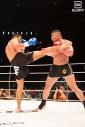 Koichi kicking LeBanner (Ben Pontier / GLORY)