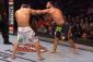 Johny Hendricks punching Robbie Lawler (photo via UFC / ZUFFA)