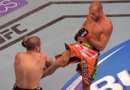 Donald Cerrone kicking Jim Miller (photo via FOX Sports / UFC)