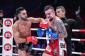 Giorgio Petrosyan punching Amansio Paraschiv (photo via Bellator Kickboxing)