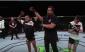 A victorious Sergio Pettis (left) (photo via UFC)
