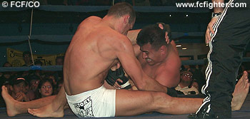 Roberto Ramirez working for a heel hook on Kestutis Arbocius