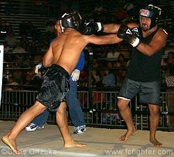 Michael Labuanan punching Louis Kuamo'o