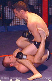 Kavanagh (top) sets up a leg lock