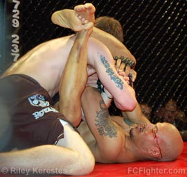 Cage Fighting Championships Underground: Ryan Bixler fending off one of Steve Kinnison's many armbar attempts - Photo by Riley Kerestes
