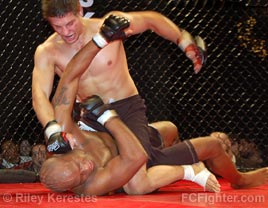 Cage Fighting Championships Underground: Tommy Lee raining down punches on Norm Alexander - Photo by Riley Kerestes