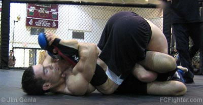 Chris Dietzal works a footlock on Nick Eiben