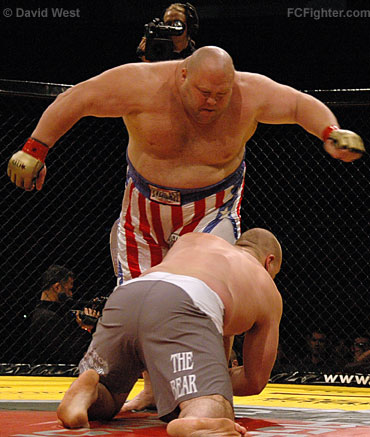 Cage Rage 19: Rob Broughton (foreground) goes low on Eric 'Butterbean' Esch for a takedown - Photo by David West