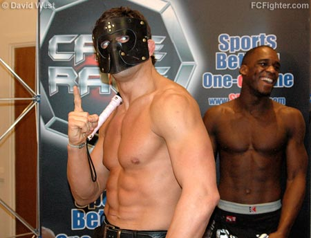 Cage Rage 19: Alex Reid posing in his bondage outfit as opponent Xavier Foupa-Pokam laughs in the background - Photo by David West