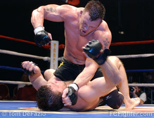 Travis Wiuff beating on Ibragim Magomedov