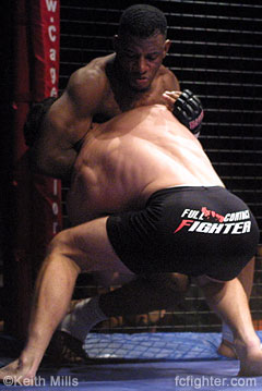 Jason Black going for a takedown on Michael Johnson