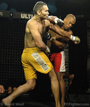 Intense Fighting (Jan 27, 2007): Antonio Samurai (left) slugs Eric Cebarec - Photo by Zack Lynch