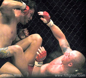 Black punching down on Chad Saunders at WFA 3