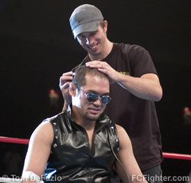 Haigh shaving Miyazaki's head after beating him