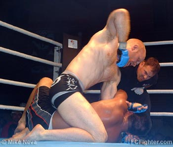 Dudley punching Narita - Photo by Mike Neva