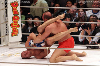 Pride FC Real Deal: Fedor Emelianenko works an armbor on Mark Coleman - Photo by Marcelo Alonso
