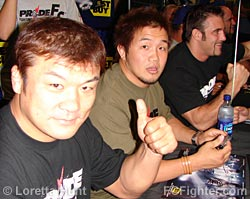Hidehiko Yoshida (left), Kazuhiro Nakamura, with Phil Baroni in the background
