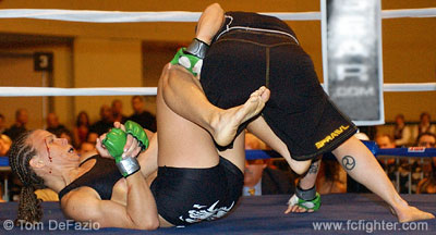 Laura D'Auguste works for a heel hook on Amanda Buckner