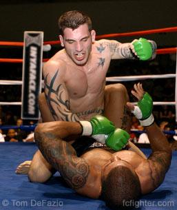 Kurt Pellegrino pounding on Muhsin Corbbrey