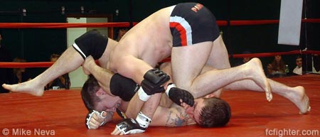 Matt Lininger fighting off a triangle with a knee to the face