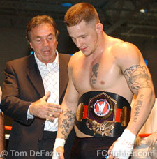 Promoter Louis Neglia presents Dante Rivera with the Super-Cruiserweight Title belt