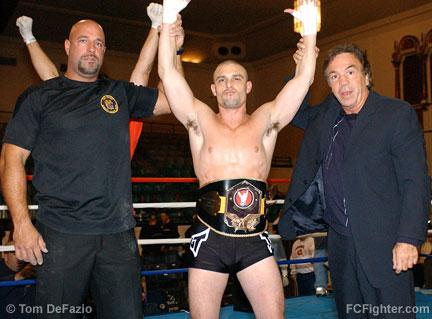 L-R: Referee Dan Miragliotta, Marlon Sims, promoter Louis Neglia