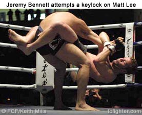 Jeremy Bennett attempts keylock on Matt Lee