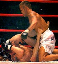 Kid Yamamoto punching Jeff Curran