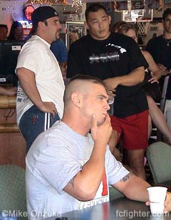 Teammates UFC's Phil Baroni and Enson Inoue talk shop while Tom Sauer concentrates on the weigh in