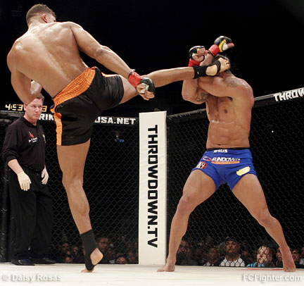 Overeem throwing a kick at Belfort