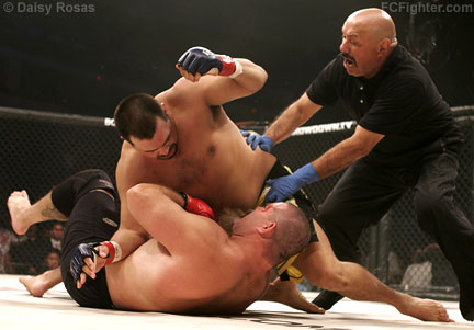 Strikeforce 3: Paul Buentello being pulled off of a KO'd David 'Tank' Abbott - Photo by Daisy Rosas