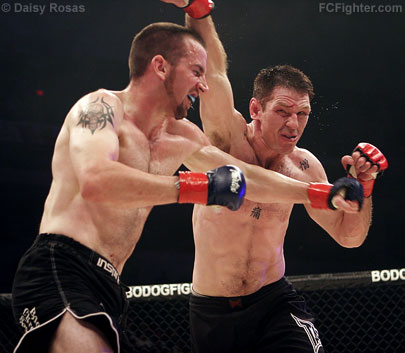 Strikeforce 3: Eric Wray (left) trading punches with Jason Von Flue - Photo by Daisy Rosas