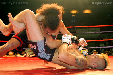 Total Fight Challenge 10: Dan Hornbuckle finshing off Alex Carter with a triangle choke - Photo by Riley Kerestes