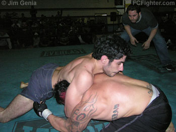 Underground Combat League (Nov. 5, 2006): Mike Milian (left) sprawls on Craig Parker - Photo by Jim Genia