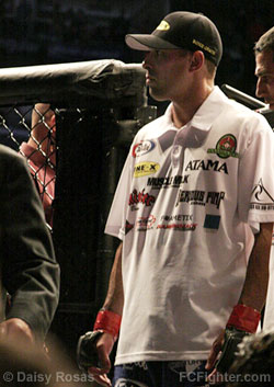 Royce Gracie leaves the cage after losing to Matt Hughes
