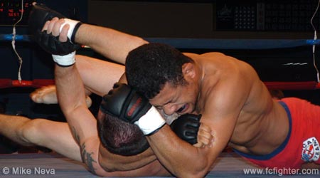 Edson Diniz putting Charles Pearson to sleep