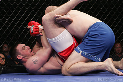 Ultime Warrior Challenge: Toby Johnson locking up a triangle choke on Eric Hill - Photo by Keith Mills