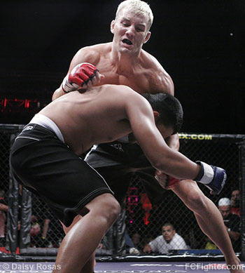 WEC 22: Casey Olson (facing camera) vs. Alvan Cacdus - Photo by Daisy Rosas