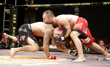 WEC 23: Alex Karalexis (right) stuffs Thomas Denny's takedown attempt - Photo by Daisy Rosas
