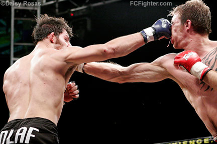 WEC 24: Olaf Alonso (left) and John Polakowski trade blows - Photo by Daisy Rosas