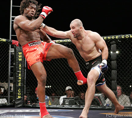 WEC 24: Glover Teixeira (right) cracks Thierry Sokoudjou - Photo by Daisy Rosas
