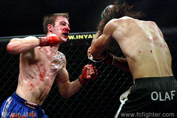 John Polakowski (left) fighting his heart out against Olaf Alfonso