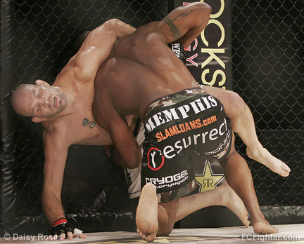 Matt 'The Law' Lindland gets picked up by Quinton 'Rampage' Jackson - Photo by Daisy Rosas