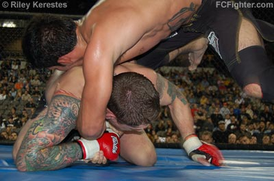 XFO 13: Rafael Assuncao hammers Jeff Curran with a knee to the body - Photo by Riley Kerestes