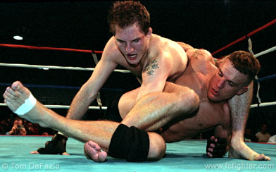 Pete Sell with a shoulder lock on Ted Govola
