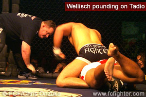 Christian Wellisch pounding on Dennis Tadio from the back mount