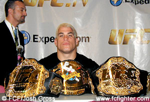 Tito Ortiz with his championship belts