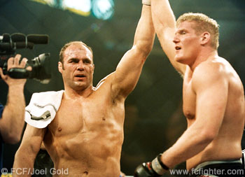 Randy Couture raises Josh Barnett's hand in victory after their fight at UFC 36