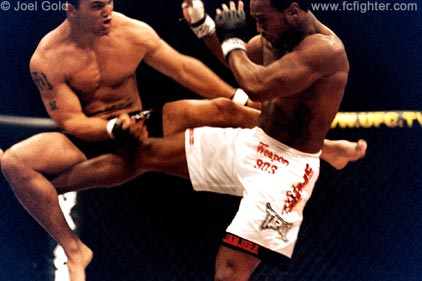 Pete Spratt kicking an airborn Robbie Lawler at UFC 42